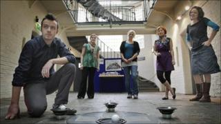 Artist Simon Proffitt at Ruthin's Old Gaol with, from left, Cadwyn Clwyd's Ceri Hughes and Cell co-ordinators Megan Broadmeadow, Rhian Haf and Julia Peat