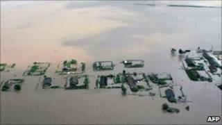 Picture released by North Korea's Central News Agency shows houses submerged in floodwaters near the Sinuiju area, North Korea