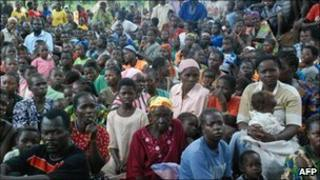 Southern Sudanese wait for food, shelter, security and medicine at the village of Nzara, along Sudan's border with DR Congo