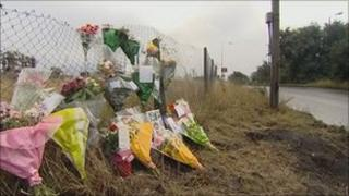 Flowers left at the scene of the crash