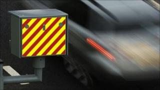 Car passing a speed camera - file photo