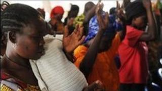 Congolese rape victims raise their hands as they pray at a chapel inside the Heal Africa clinic in Goma on August 9, 2009