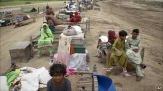Pakistani villagers who fled from their homes due to heavy flooding are seen living on an embankment in Thatta, near Hyderabad, Pakistan, Tuesday, Aug. 24, 2010.
