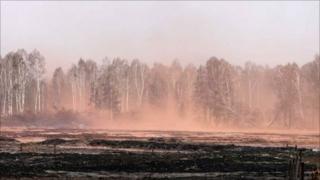 A burnt field near a village of Kadanok some 150 km outside Moscow