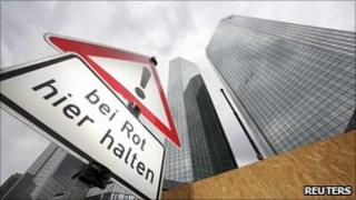 "Road sign saying ""stop here on red light"" outside Deutsche Bank's headquarters in Frankfurt"