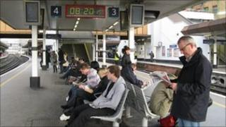 Commuters waiting for a train at London Bridge station