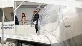 Asil Nadir and his wife Nur leave their plane at Luton Airport