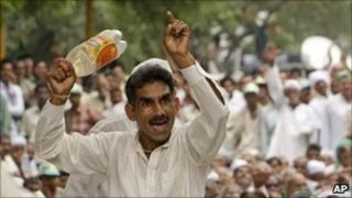 A farmer gestures at a protest rally in New Delhi, India, Thursday, Aug. 26, 2010