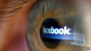 Facebook logo in human eye, PA