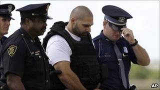 Police escorting Elias Abuelazam at an airport in Michigan