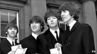 Beatles receive their MBEs in 1965