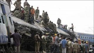 Indian rescue workers at the scene of a train crash in West Bengal, India, in May 2010