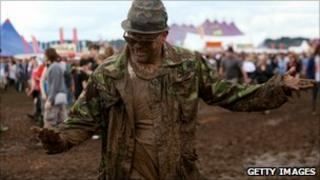 Reading festival goer in mud