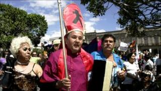 Gay rights campaigners protest outside Guadalajara cathedral