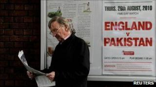 Man reading a newspaper outside Lords cricket ground