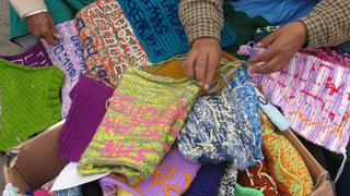 Women assemble the Scarf of Hope
