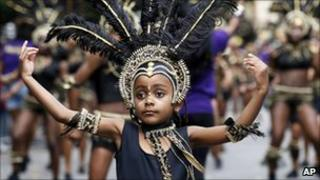 A young girl taking part in one of the carnival parades