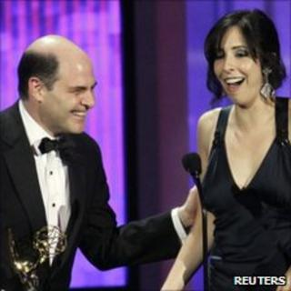 Matthew Weiner and Erin Levy accept the award for outstanding writing