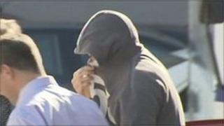 Teenage murder suspect in hood
