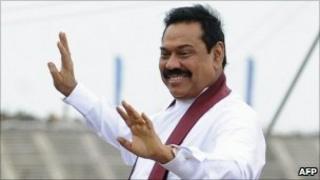 Sri Lankan President Mahinda Rajapaksa waves at supporters in Hambantota on August 15, 2010.
