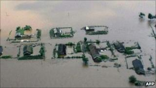 Image released on 21 August by North Korean news agency KCNA shows flooding in Sinuiju area
