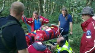 Rescue workers tend to the woman