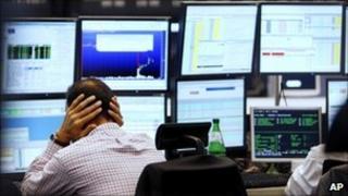 Broker facing computer screens in Frankfurt