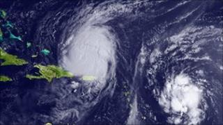 Satellite image of hurricane Earl (l) and Tropical Storm Fiona on 31 August 2010