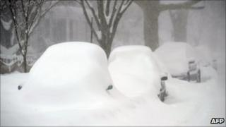 Cars blanketed under thick snow in Washington DC