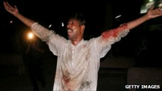 A man mourns after the Lahore blasts of 1 September 2010