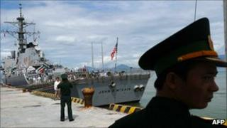 A Vietnamese guard stands near a US destroyer in the Vietnamese port of Danang on 10 August 2010