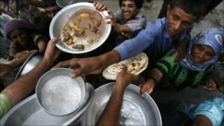 Flood victims receive food at a camp