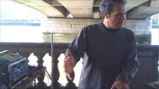Nick Franglen playing his theremin under London Bridge