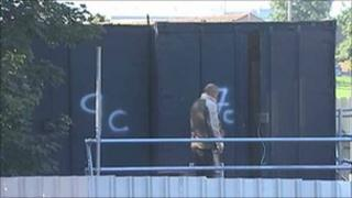Man enters shipping container