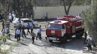 Police and firefighters at the site of a bomb explosion in Khujand, Tajikistan, 3 September 2010