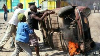 Protesters overturn a burning car (2 September)