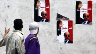 Egyptians walk by posters of Omar Suleiman in Giza, Cairo, 2 September