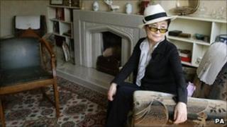 Yoko Ono, inside John Lennon's childhood home
