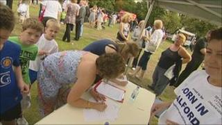 People signing maternity closure petition