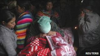Relatives mourn a victim of one of the landslide to hit Guatemala