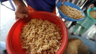 Bowl of rice at food distribution point in Pakistan