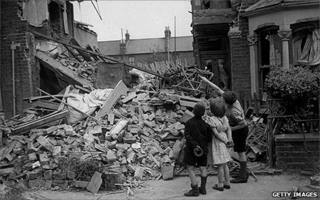 Children examine wreckage in east London