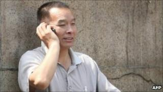Chinese man chats on his mobile phone in Beijing
