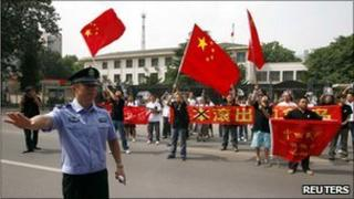 Protesters gather outside the Japanese embassy in Beijing