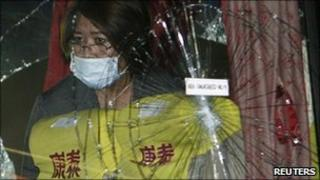 Philippine Justice Secretary Leila De Lima looks inside the bus that was used in the August 23 hostage crisis, in Manila on 8 September, 2010