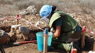 A UN peacekeepers clears mines along the Israeli-Lebanese frontier