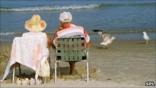 An elderly couple on the beach