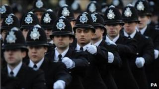 Newly qualified police officers at the Peel Centre in Hendon, north London take part in a passing out parade.
