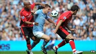 Manchester City's James Milner (centre) battles with Blackburn Rovers' El-Hadji Diouf (left) and Ryan Nelson during the match at the City of Manchester Stadium