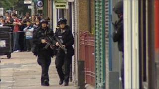 Armed police during flat siege